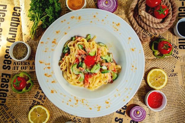 Fettucine carbonara in the plate top view Free Photo
