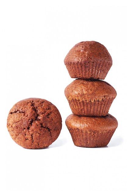 A few dark chocolate dough muffin on isolated on white background. Premium Photo
