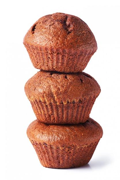 A few dark chocolate dough muffin on isolated. Premium Photo