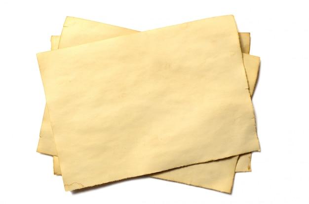 Few old blank pieces of antique vintage crumbling paper manuscript or parchment Premium Photo