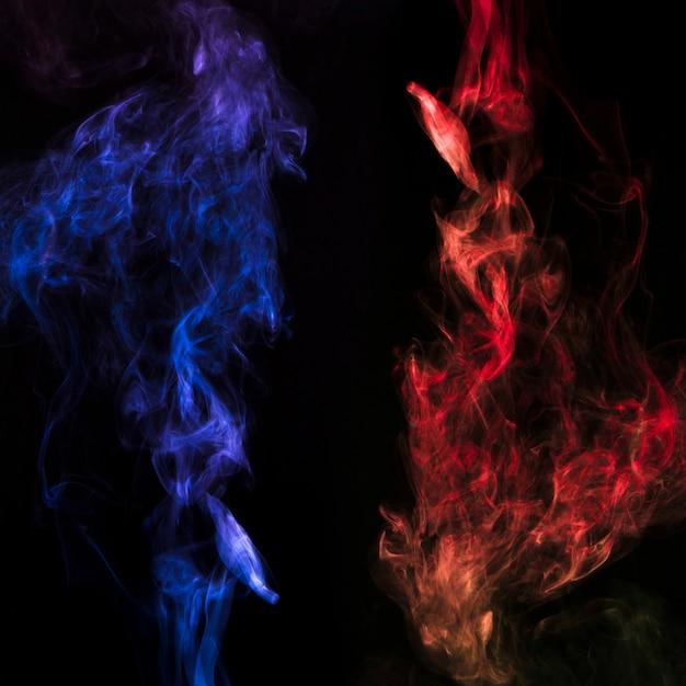 A fiery smoke effect pattern against black backdrop Free Photo