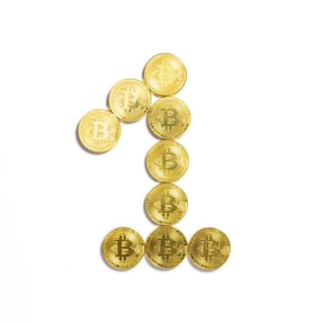 The figure of 1 laid out of bitcoin coins and isolated on white background Free Photo