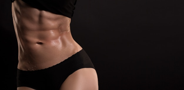Figure of a sports girl on a black background Premium Photo