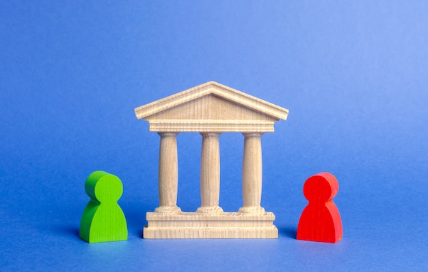 Figures of people stand near the government building, court, bank. Premium Photo