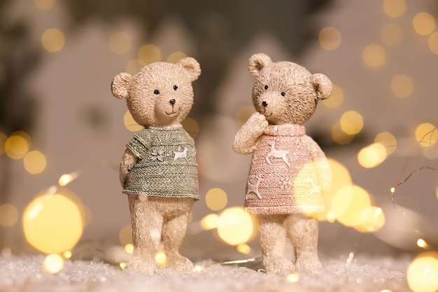 Figurines of cute teddy bears of a boy and a girl in sweaters with deers Premium Photo