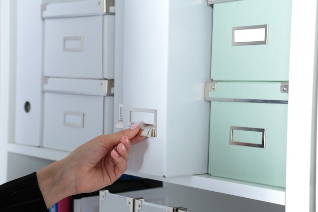 File folders, standing on shelves in the background Premium Photo