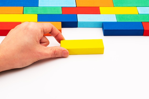 Fill in business solutions concept, a piece of wooden block puzzle fit in a blank space Premium Photo