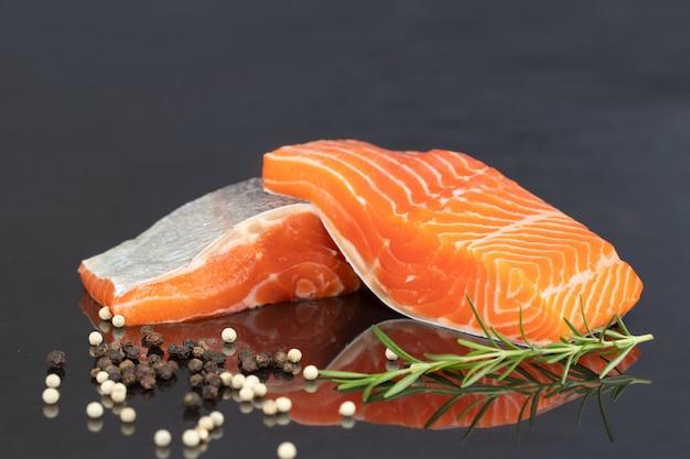 Fillet of salmon on black Premium Photo