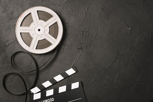 Film bobbin and clapperboard Free Photo