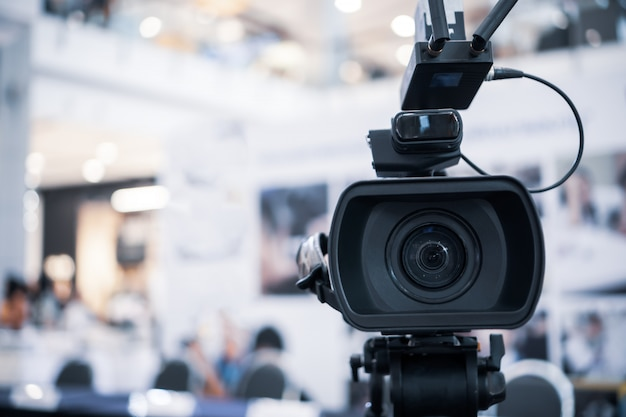 Film lens of video camera recording film shooting of grand opening in conference hall live streming Premium Photo