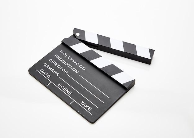 Film slate lying open against white Premium Photo