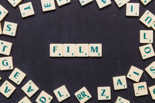 Film word arranged with scrabble letters Free Photo