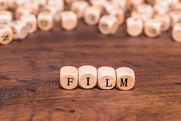 Film word written on wooden cubes Free Photo