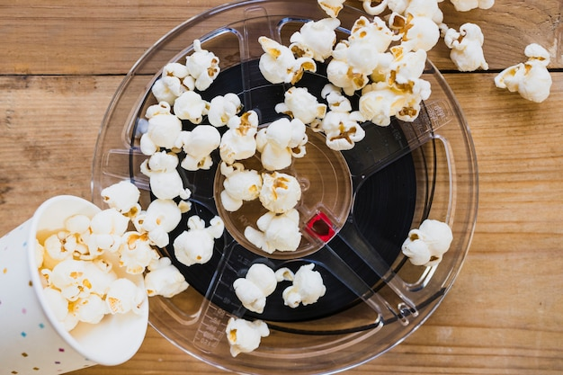 Filmstrip and popcorn in cup Free Photo