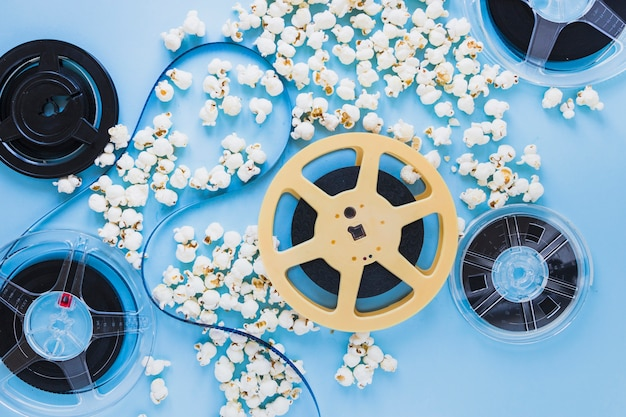Filmstrip on tapes in popcorn Free Photo