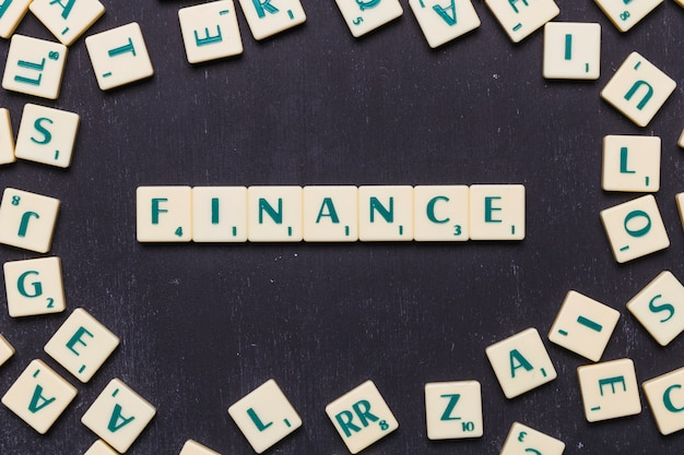 Finance word made with scrabble letters Free Photo