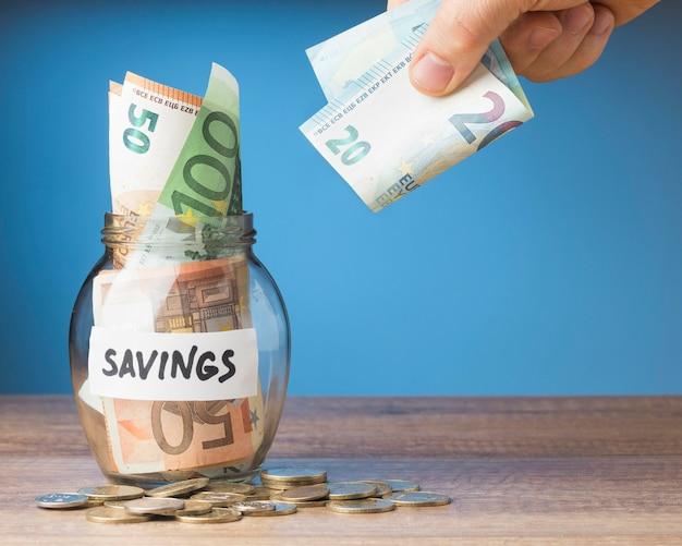 Finances arrangement with banknote savings Free Photo