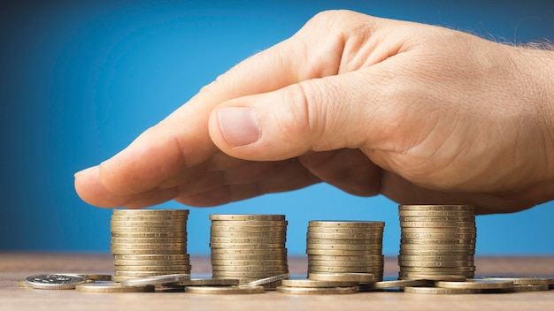 Finances arrangement with bunch of coins Free Photo