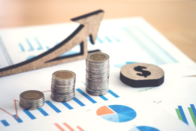Financial banking stock spreadsheet with stack of coin and background on accountant data Premium Photo