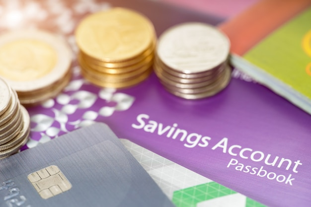 Financial concept, saving account passbooks, credit card and coin Premium Photo