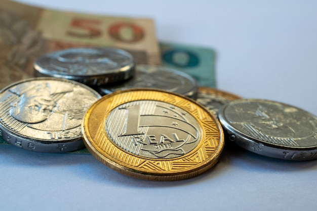 Financial control concept with brazilian money, coins and banknotes. Premium Photo