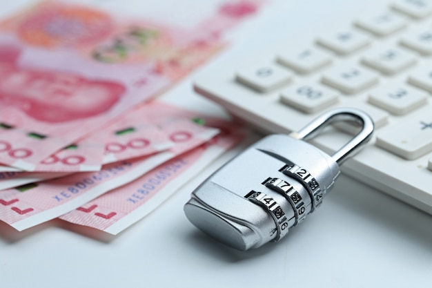 Financial security password lock and banknotes on white background Free Photo