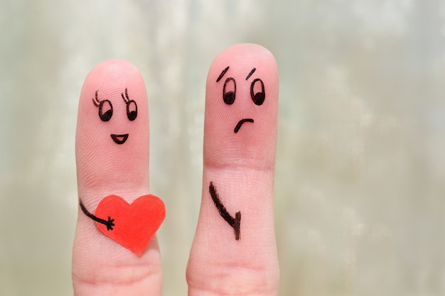 Finger art of a couple. the concept is not shared love. Premium Photo