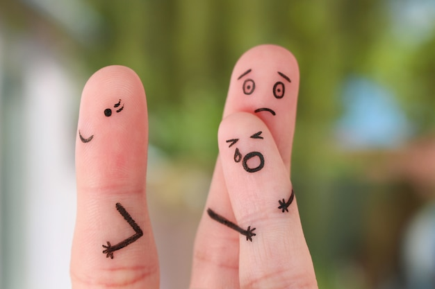 Finger art of family during quarrel, concept of child remained with father, mother left to go out. Premium Photo