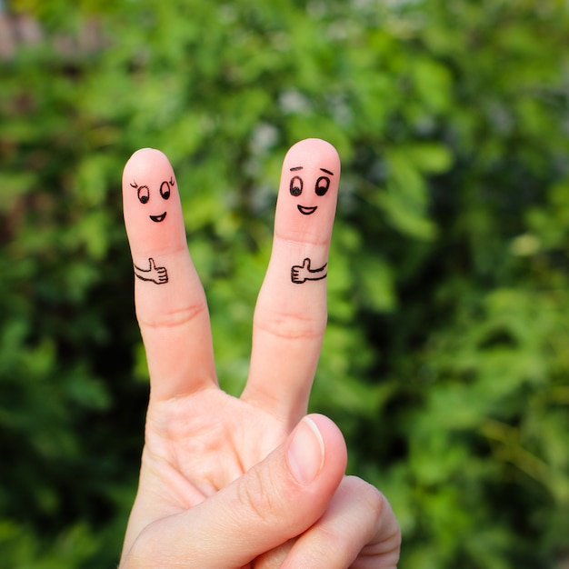 Finger art of happy couple showing thumbs up Premium Photo