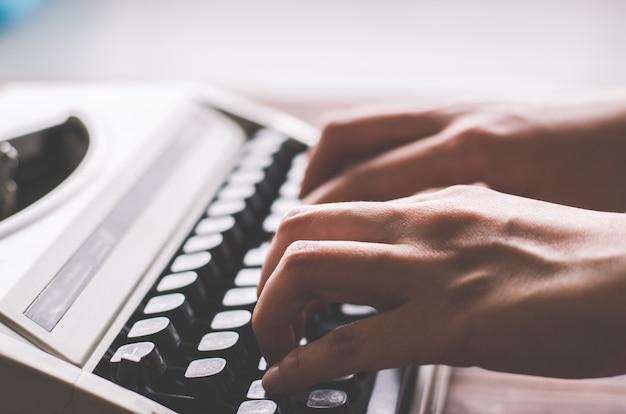 Finger hold on button in vintage typewriter Premium Photo