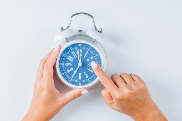 Finger pointing at alarm clock Free Photo