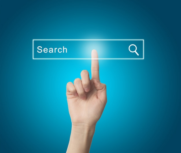 Finger pressing a search engine Free Photo