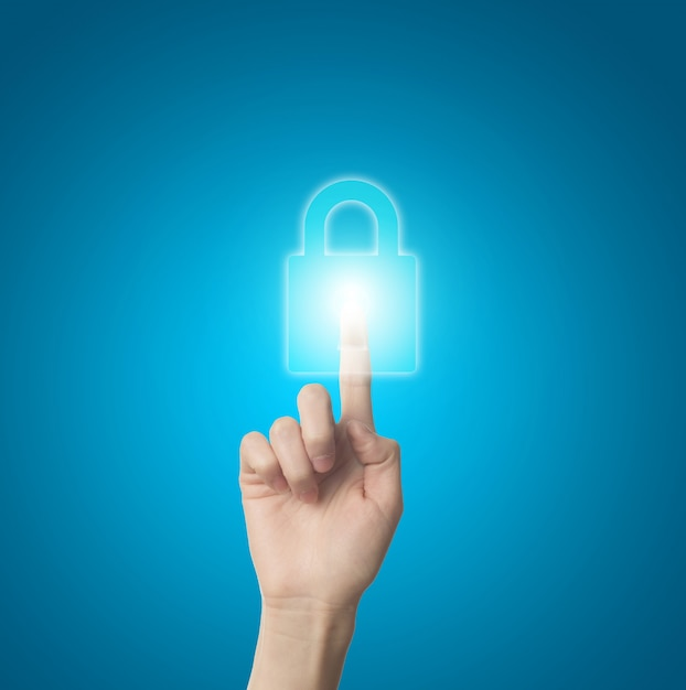 Finger pressing a virtual lock Free Photo