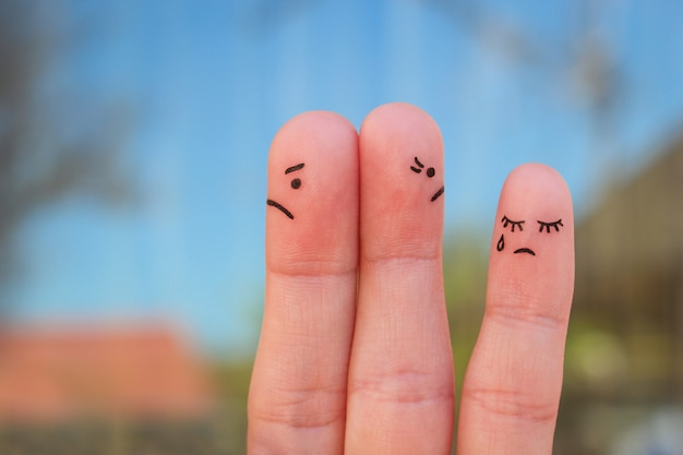 Fingers art of couple after an argument looking in different directions Premium Photo