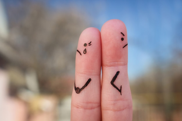 Fingers art of couple. couple after an argument looking in different directions. Premium Photo