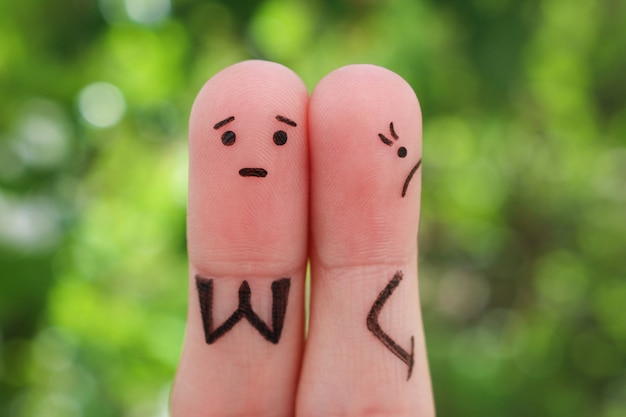 Fingers art of displeased couple. woman was offended, man asks her forgiveness. Premium Photo