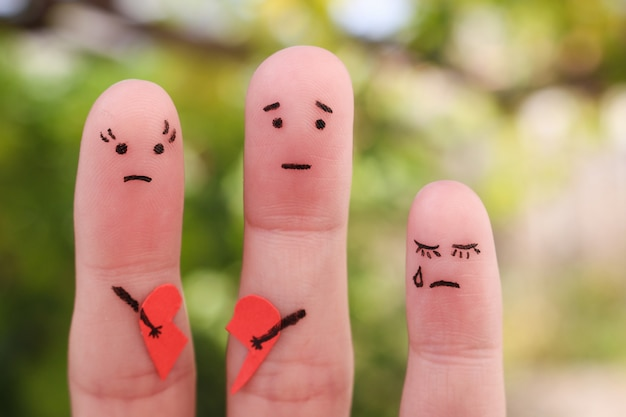 Fingers art of family during quarrel. concept of parents had fight, child was upset. Premium Photo
