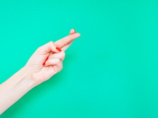 The fingers crossed hand sign Premium Photo