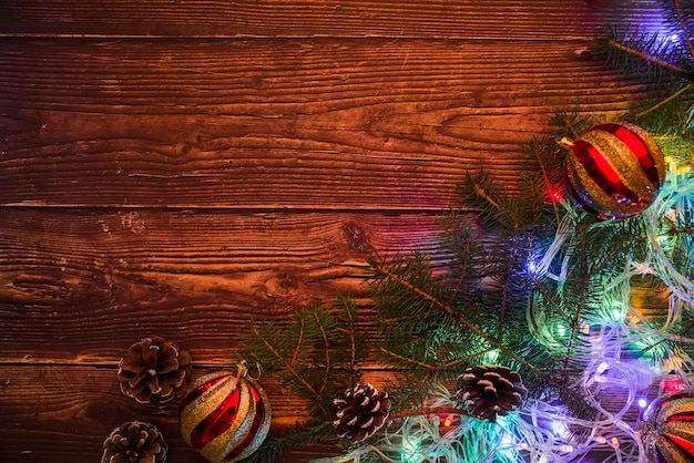 Fir tree branches with baubles and garland Free Photo