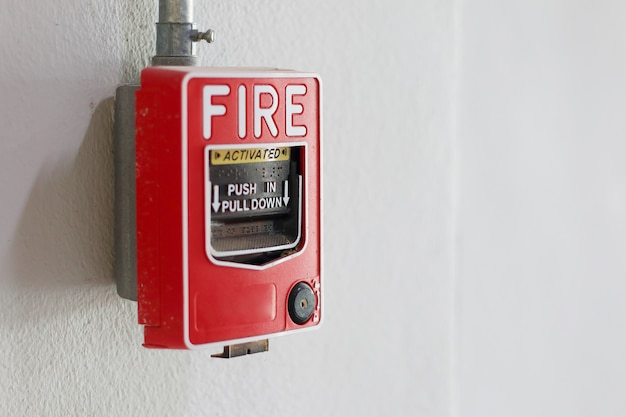 Fire alarm switch on the wall in factory. Premium Photo