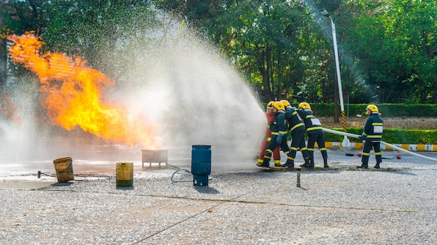 Fire drill training or fireman presentation in outdoor. Premium Photo
