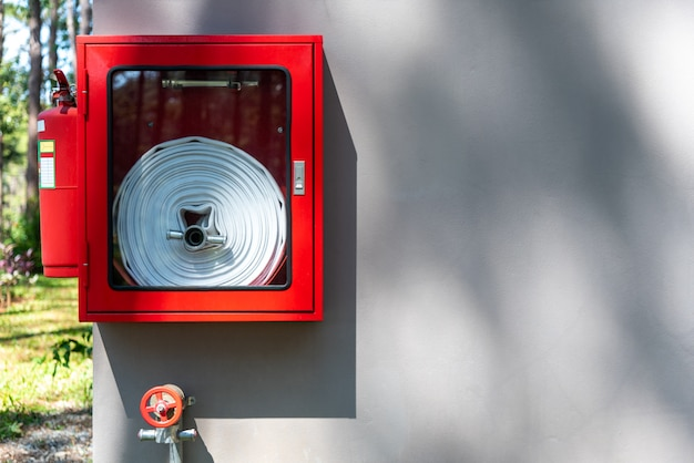 Fire equipment which installed on the wall of the building. Premium Photo