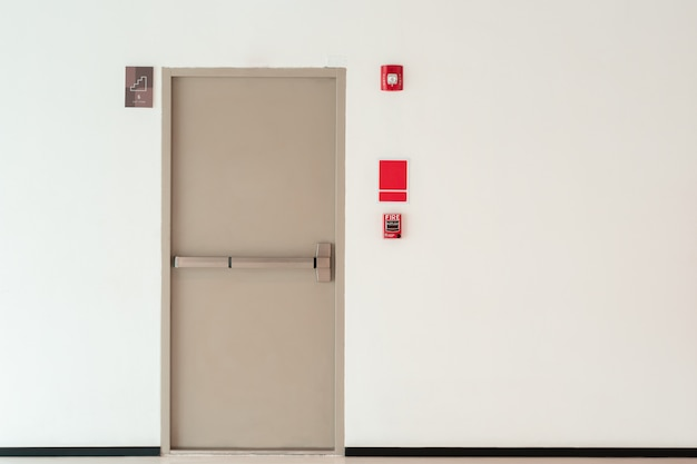 Fire exit door background with copy space wall, interior office building Premium Photo
