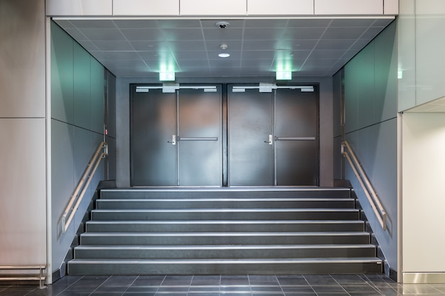 Fire exit metallic doors with staircase Premium Photo