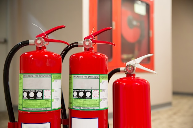 Fire extinguisher with fire hose prepare for fire safety and prevention. Premium Photo