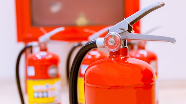 Fire extinguishers available in fire emergencies. Premium Photo