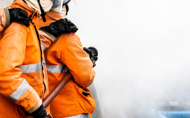 Fire fighter in full gear standing outside Premium Photo