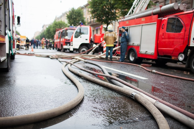 Fire hoses on the background of fire trucks. Premium Photo