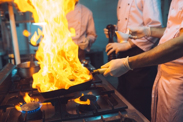 Fire in the kitchen. fire gas burn is cooking on iron pan,stir fire very hot Premium Photo