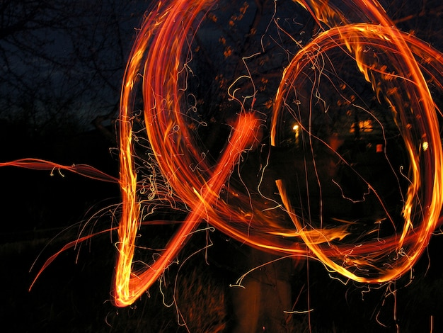 Fire movement effects in the night Photo | Premium Download
